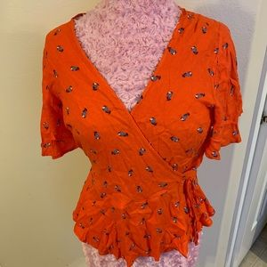 Orange floral blouse